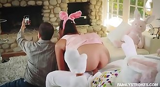 Sneaky sex with a sexy teenage getting fucked by her uncle clad up as an Easter bunny behind her par